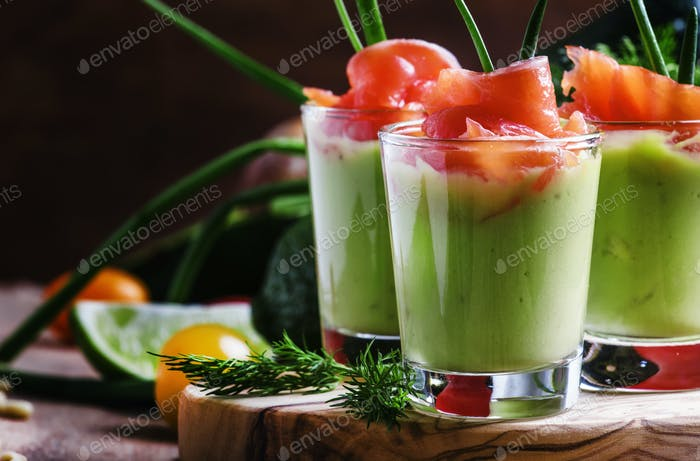 Appetizer with smoked salmon and avocado mousse, served in glasses