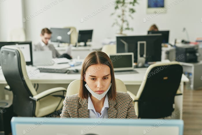 Woman working in office during quarantine
