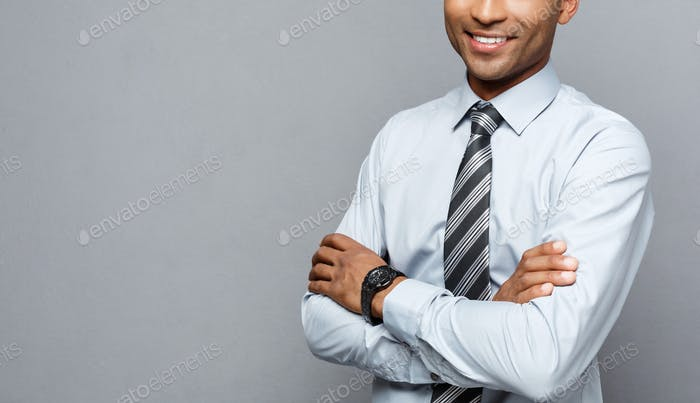 Business Concept - Happy professional african american businessman confident arms crossed