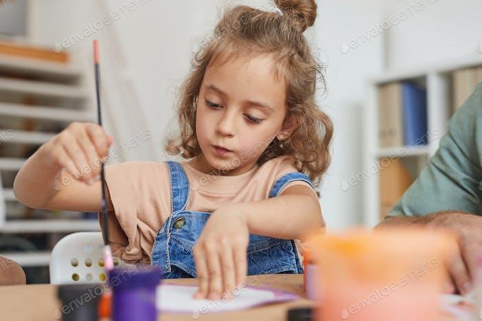 Cute Girl in Art and Craft Class