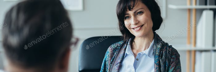 Middle age elegant female boss during job interview with senior manager