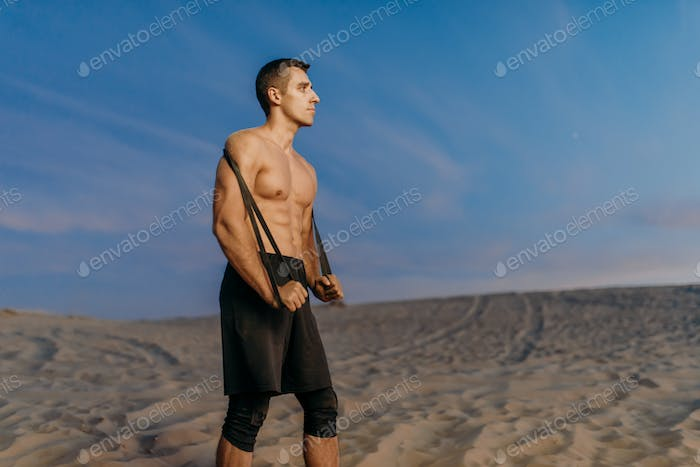 Male athlete, fit cross workout in desert