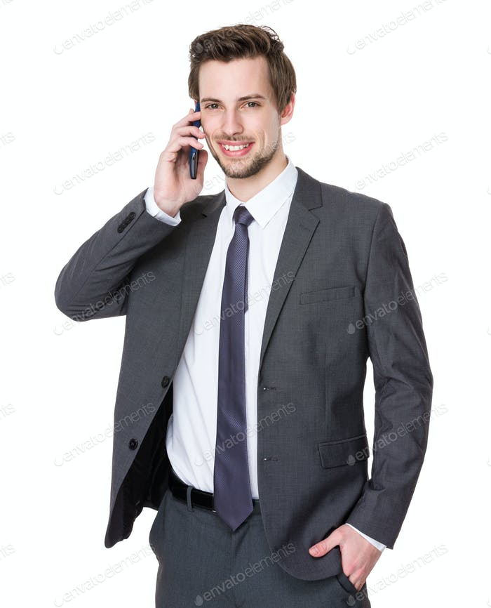 Caucasian young businessman talk to cellphone