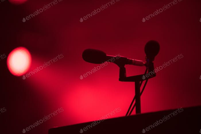Microphone in red stage lights