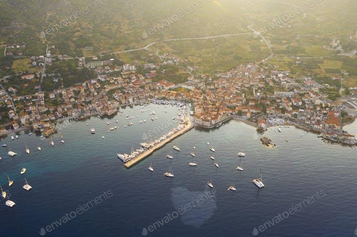 Aerial view of Mediterranean fishing village Komiza in the morning