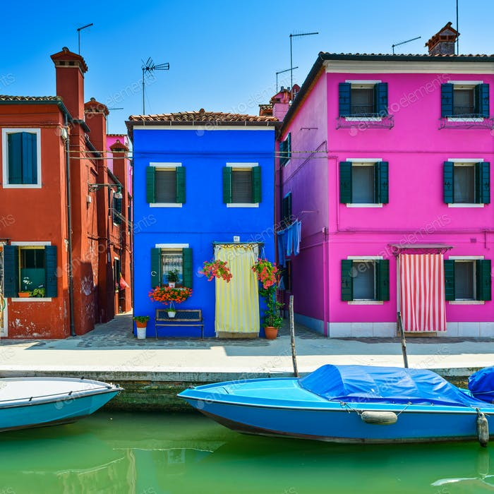 Venice landmark, Burano island canal, colorful houses and boat,