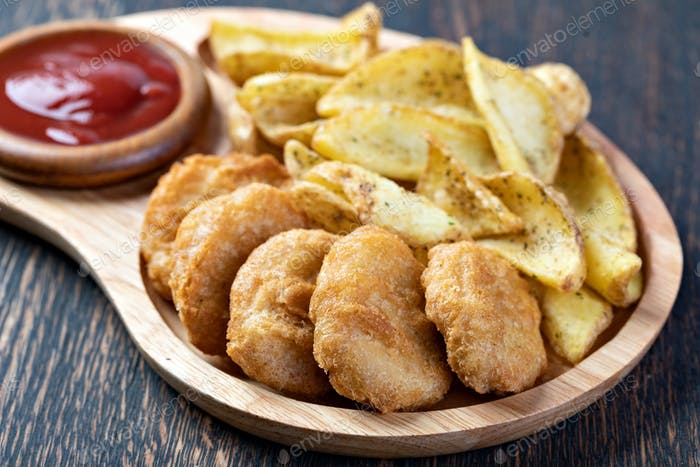Tasty fried nuggets and potatoes