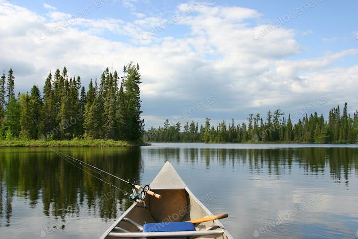 Canoe with Fishing Gear Heading Out on Minnesota Lake