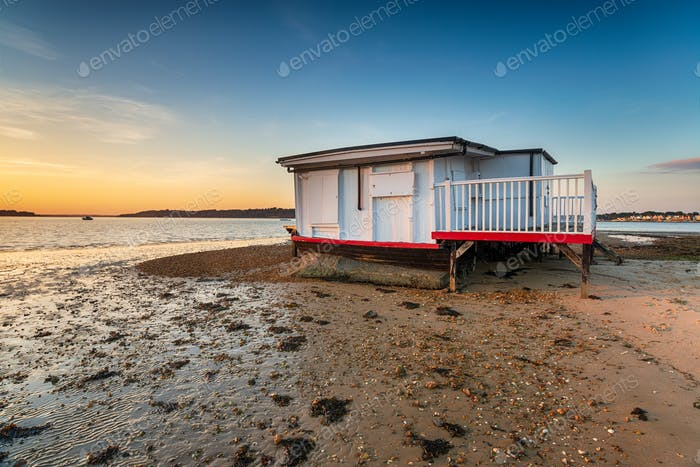 An old houseboat moored on the beach at Studland