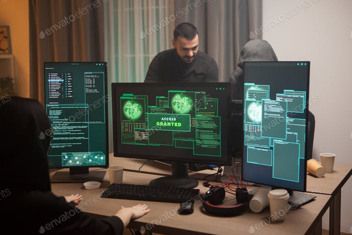 Happy female cyber terrorist after hacking a firewall