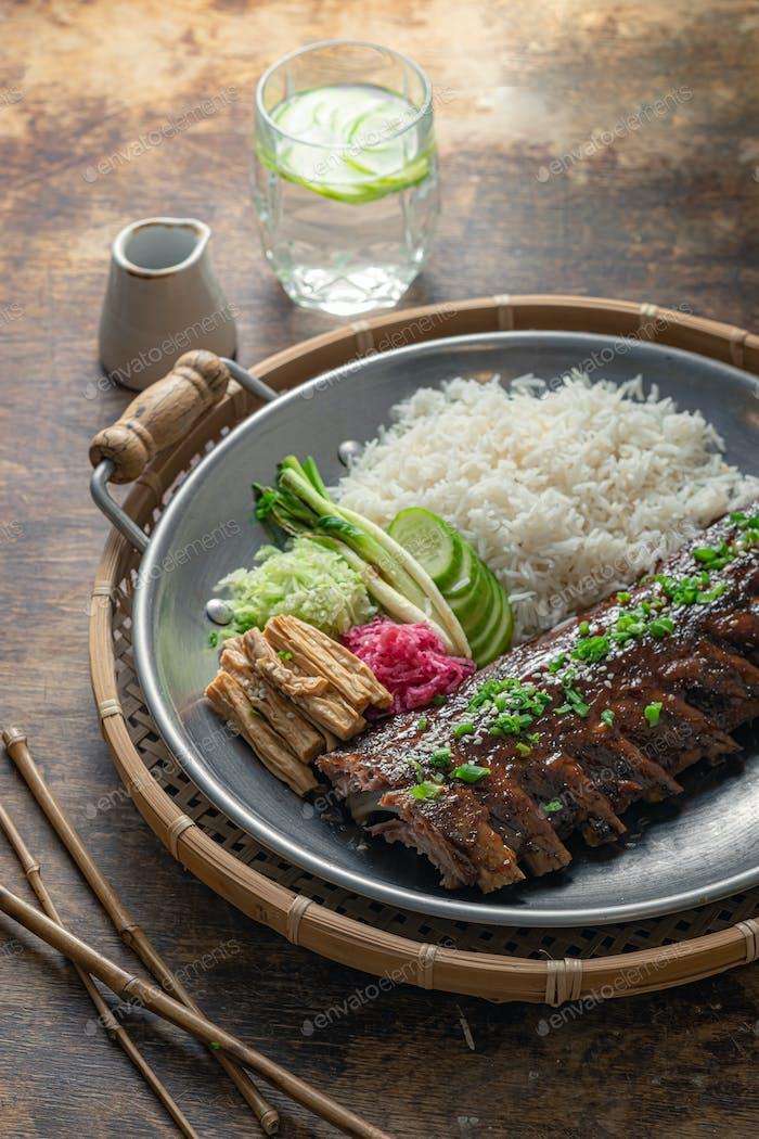 Closeup pork short ribs asian cuisine, rustic style