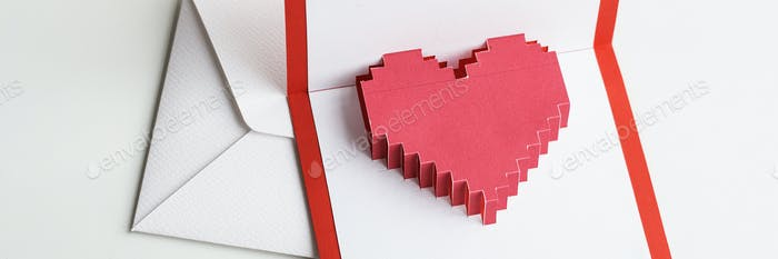 Pixelated heart in an envelope