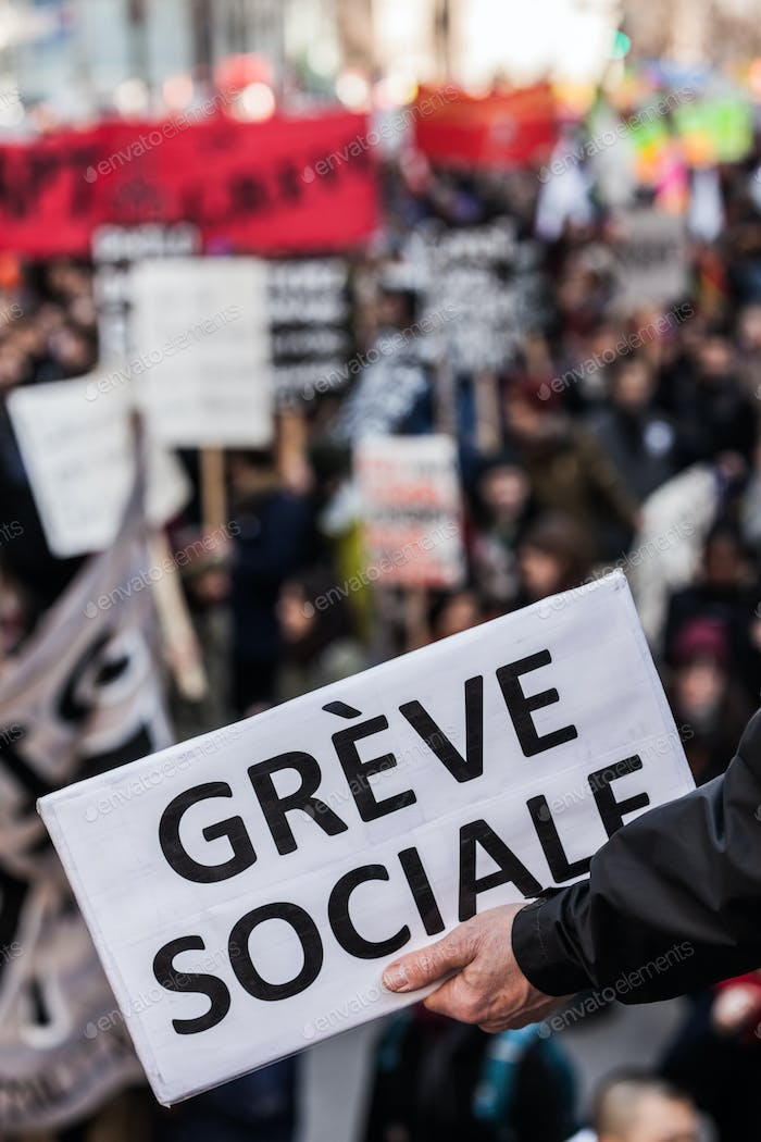 "Someone Holding a Sigh Saying ""Greve Sociale"" (French) with Blu"