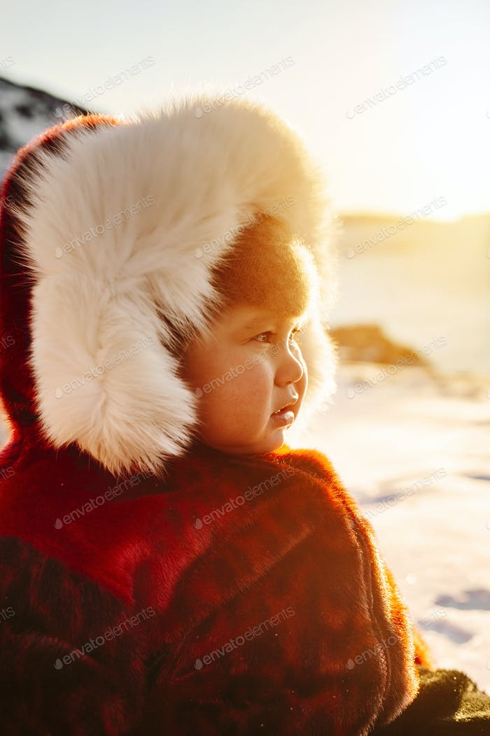 Portrait of baby boy (18-23 months) in winter coat