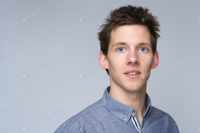 Guy posing against gray background