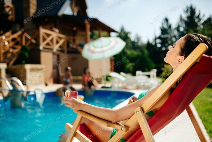 Beautiful woman sunbathing with joy