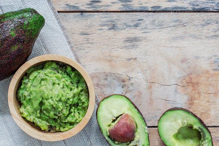 Avocado on wooden floor