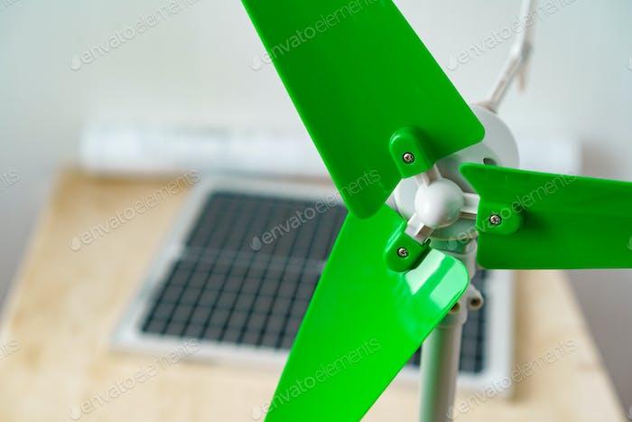 Plastic windmill model propeller indoors close up