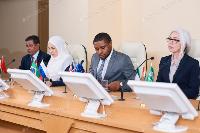 Row of contemporary young and mature intercultural politicians