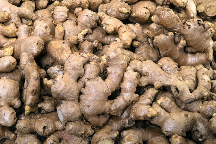 Ginger roots close up display in the fresh vegetable market