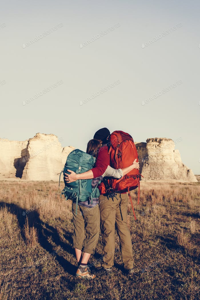 Couple hiking together in the wilderness