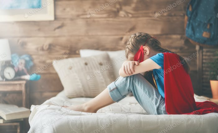 child crying in superhero costume