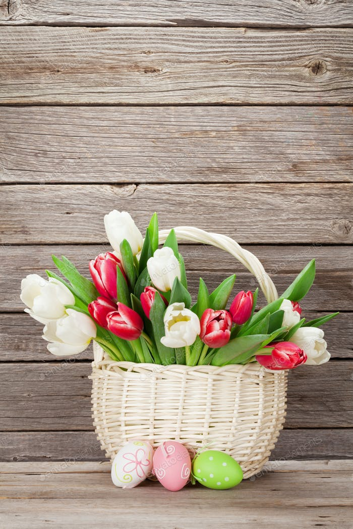 Colorful tulips bouquet basket and easter eggs