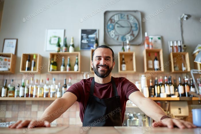 happy man or waiter at bar or coffee shop