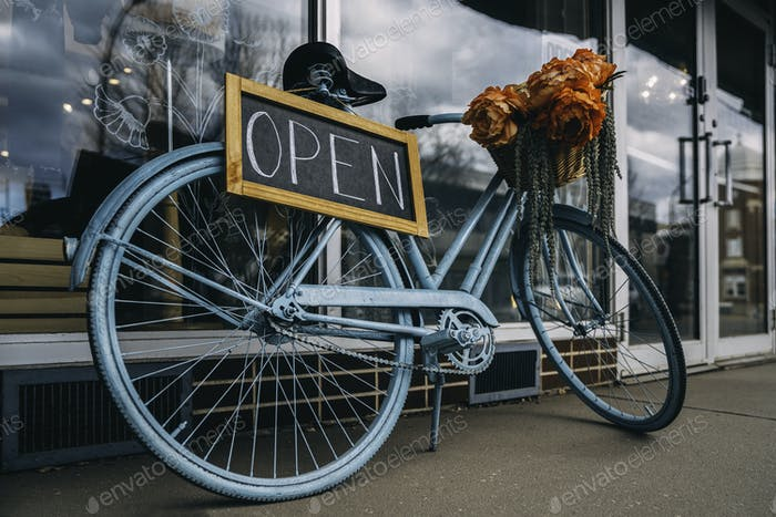Open signboard.Bicycle.Creative sign for the store.