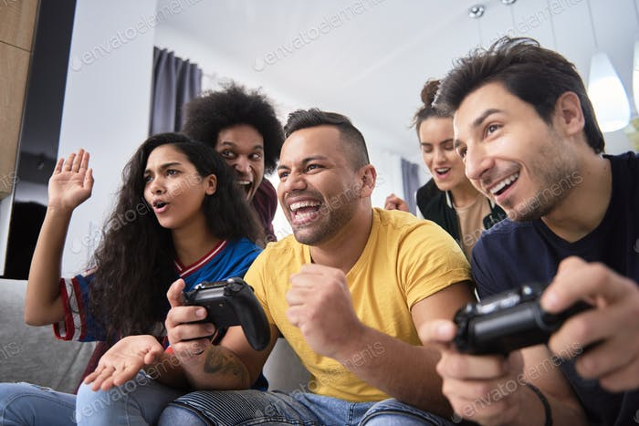 Friends have fun while playing on the game console