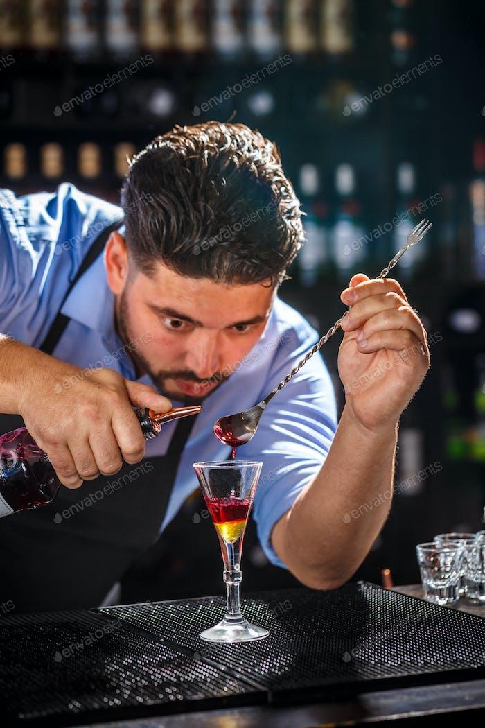 Bartender is preparing cocktail