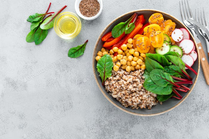 Vegetarian Buddha bowl with boiled buckwheat, chickpea and vegetables, top view