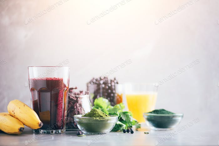 Fresh blueberries, bilberry, barley grass juice, spirulina, orange juice, dulse and cilantro on