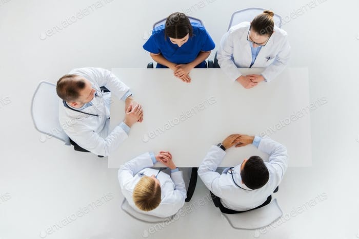 group of doctors sitting at empty table