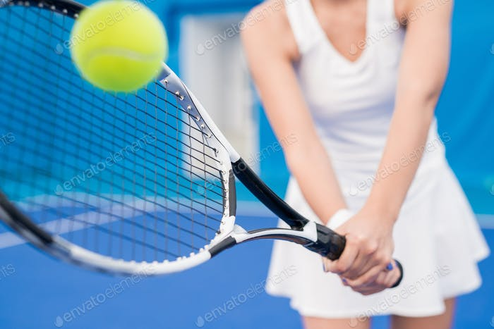Unrecognizable Woman Playing Tennis
