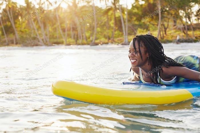 Woman swimming on sup board