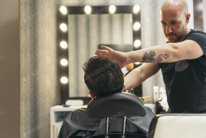 Bearded Man Getting Beard Haircut With A Razor By Barber