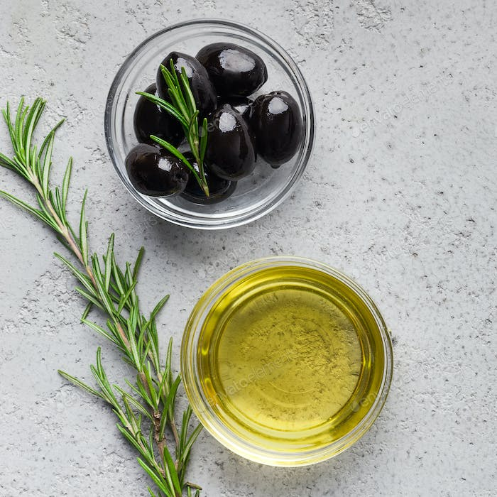 Olive oil, rosemary and olives composition