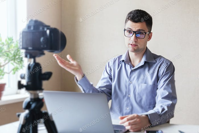 Young man conducting a webinar