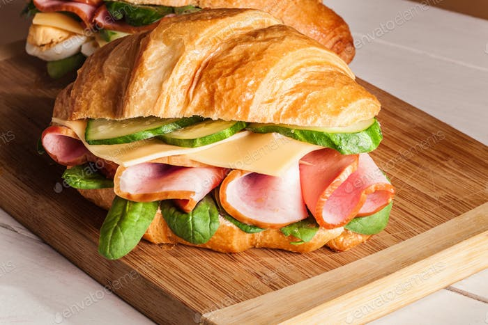 Thumbnail for Croissants sandwiches on the wooden cutting board