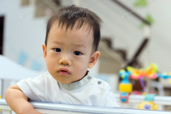 Asian baby cute boy in crib