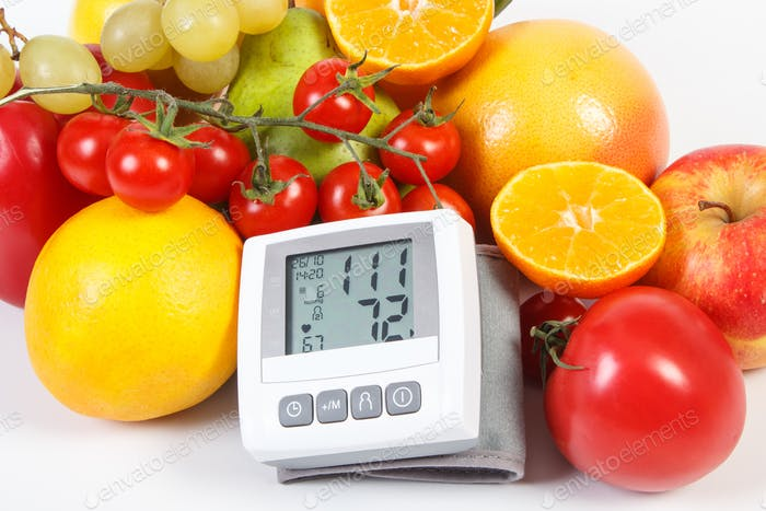 Blood pressure monitor and fresh ripe fruits with vegetables, healthy lifestyle and nutrition