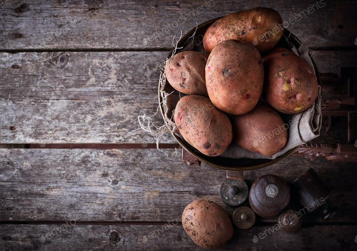 Potato on vintage rusted weight