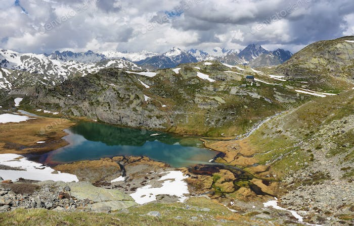Amazing turquoise Lake on the way to Rutor Glacier, Aosta Valley, Italy