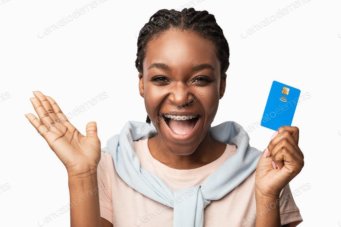 Excited Black Millennial Woman Holding Limitless Credit Card, White Background