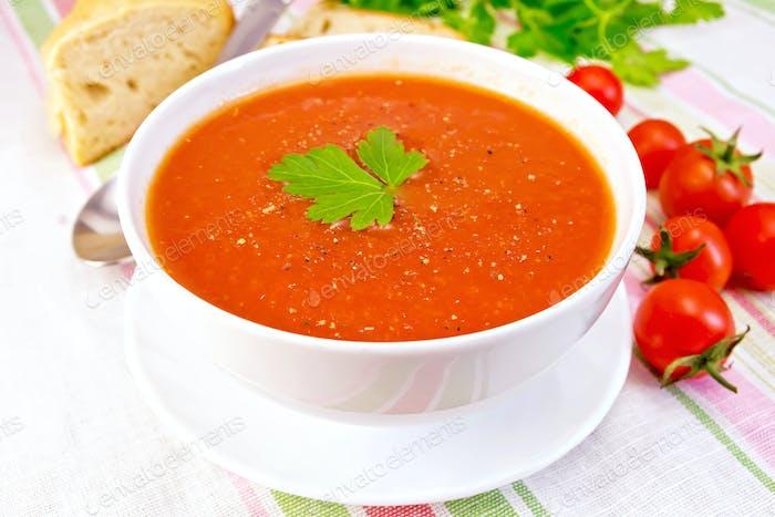 Soup tomato in bowl on linen napkin