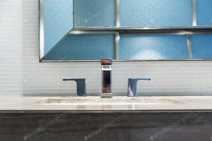 Modern washbasin with chrome faucet