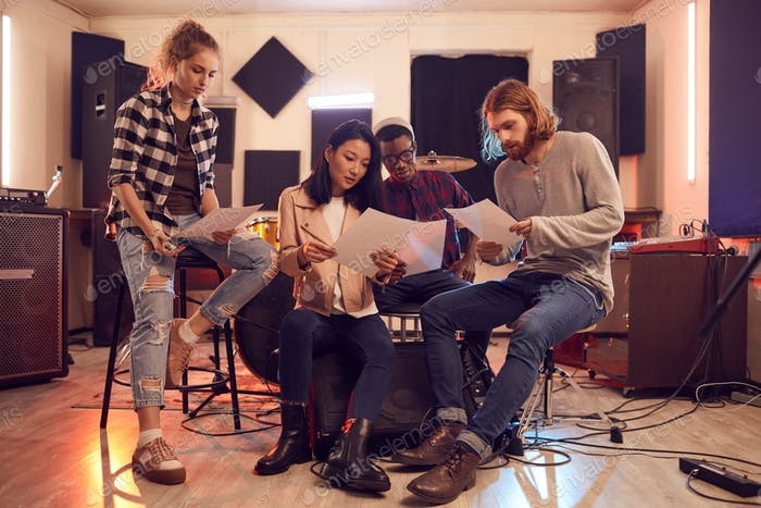 Musicians Writing Song in Studio