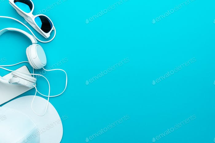 Flat Lay Image Of Modern Teenager Accessories On Blue Background With Copy Space
