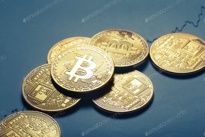 Virtual currency bitcoin lies on paper with a growing graph